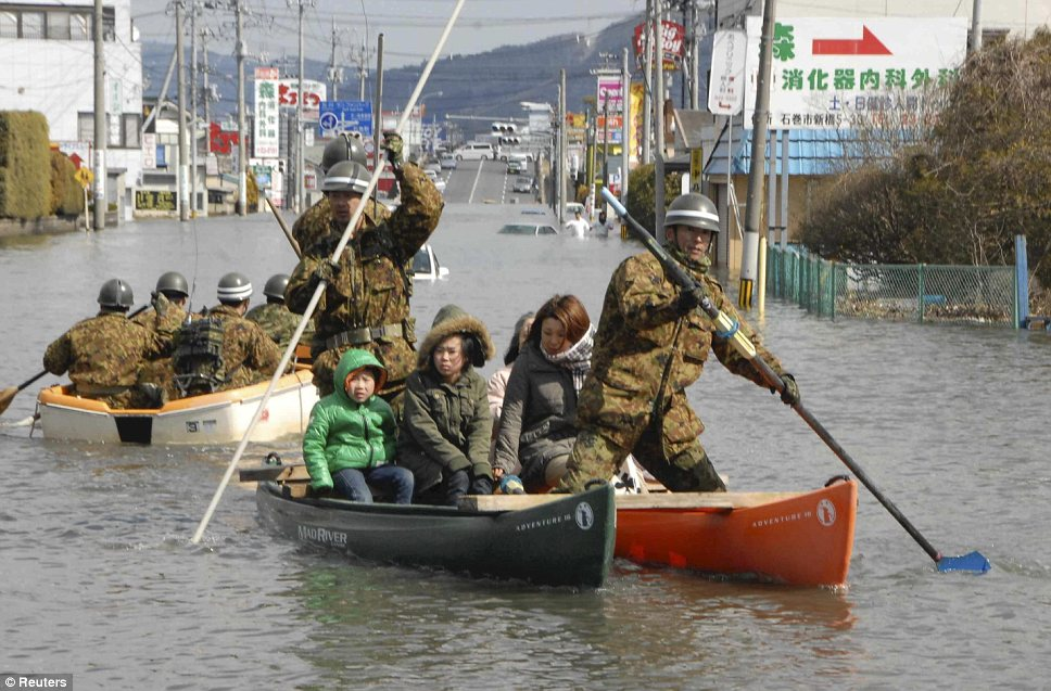 japan flood rescue 6 10 Japan Earthquake Pictures – Tsunami Flood Photos – 2011
