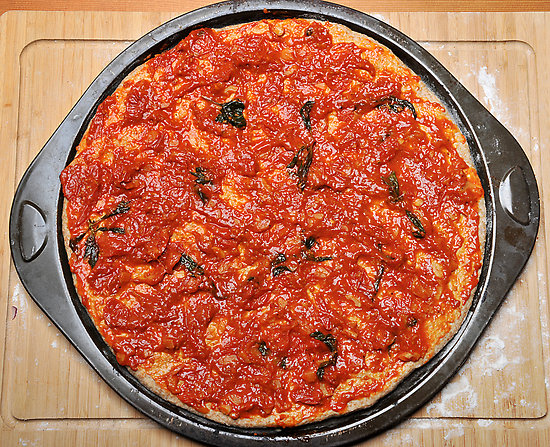 extra tomato sauce pizza 10 Most Delicious Pizza Toppings