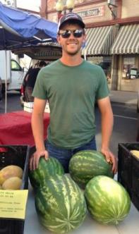 Kavan selling watermelons at the Pendleton, Oregon Farmers Market