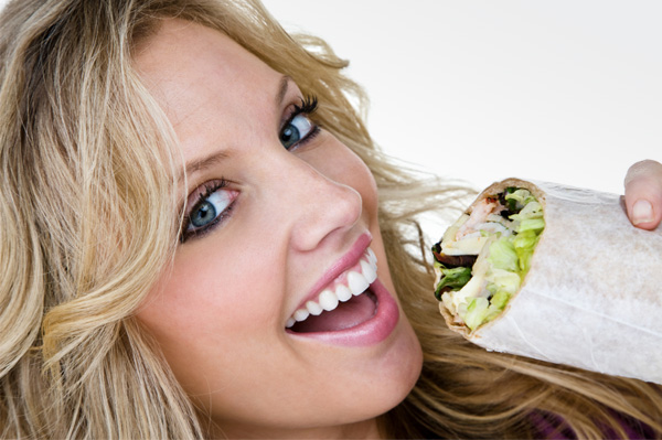 woman-eating-sandwich-wrap